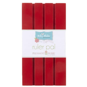 Ruler pal is a piece of painted wood with shallow grooves made for holding quilting rulers.  Red Color. Designed by Pleasant Home for Riley Blake Designs.