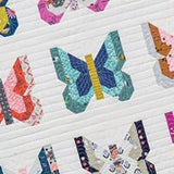 Madame Butterfly quilt pattern by Vanessa Goertzen of Lella Boutique.  Scrappy butterflies on white background.