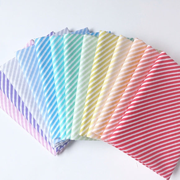 Sweet Shoppe by Andover Fabrics colorful bias striped fabric in a rainbow of colors on quilting cotton.