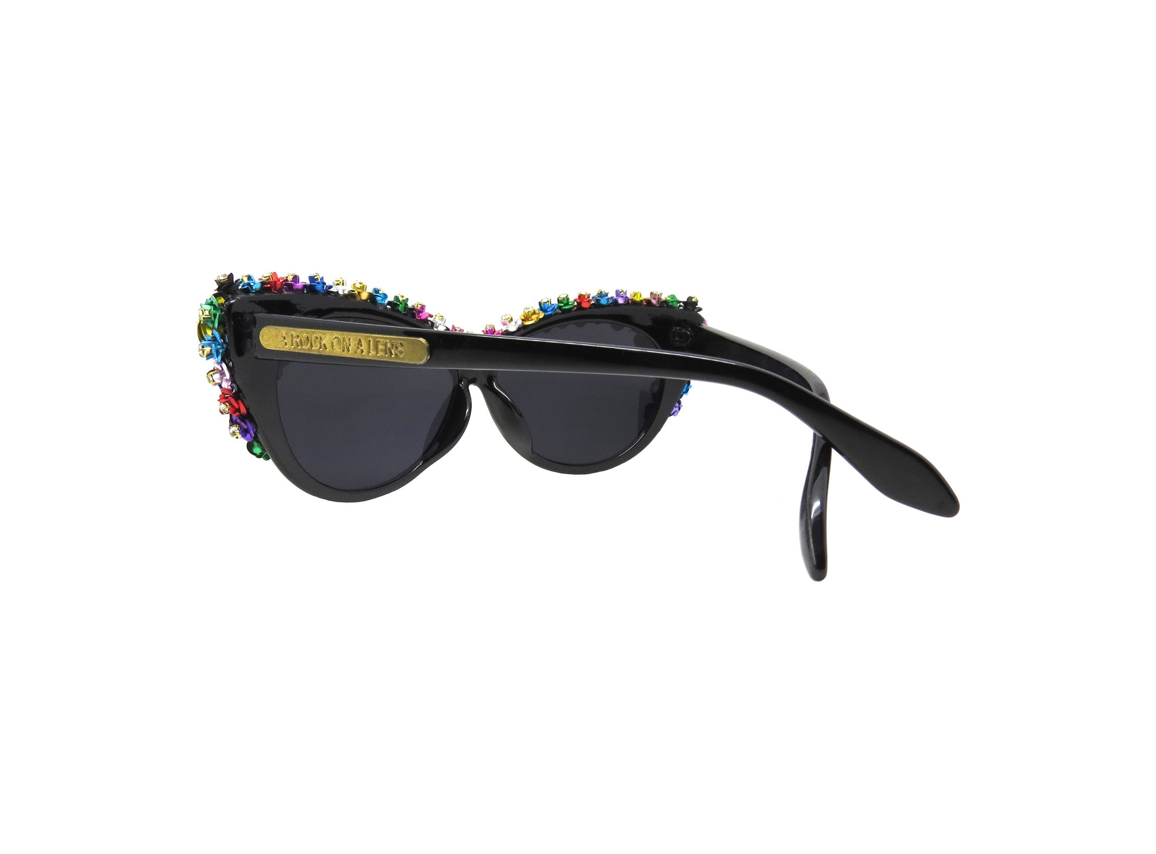 Custom made cat-eye sunglasses, hand detailed with metal flowers and large Swarovski crystals.