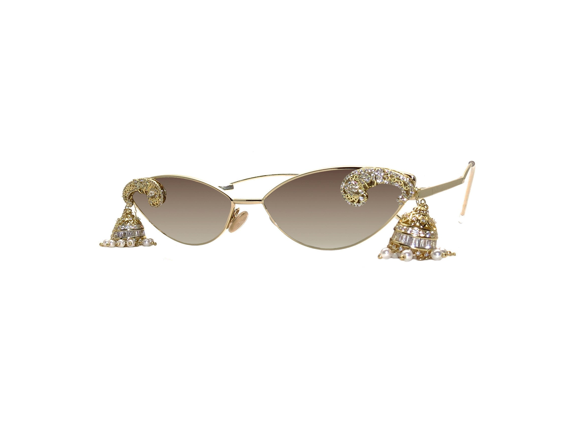 Unique cat-eye sunglasses with gold plated middle eastern cubic zirconia detail. Hand Embellished in Melbourne, Australia