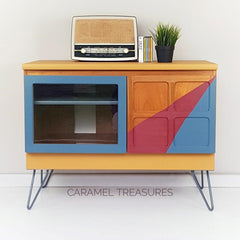 Retro Nathan mid century teak TV unit painted in fusion mineral paint Mustard, Seaside and Cranberry by Caramel Treasures near Leeds West Yorkshire