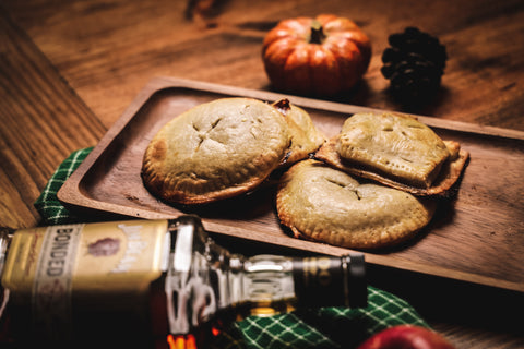 Pumpkin and Apple Hand Pies with a bottle of Jim Beam Bottled in Bond