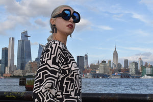 Female hippe style sunglasses, L'Orbitalli Riviera sunglasses in front of The New York City skyline 🏙 in Hoboken New Jersey, 07030