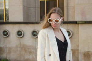 Laetitia Helfer wearing white retro sunglasses on the Trocadero in Paris, by Nouvelle Chicane