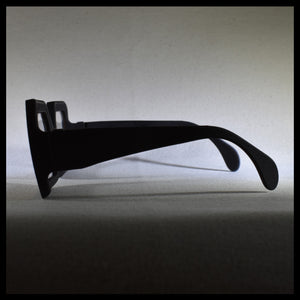 black rectangular sunglass fashion frames sitting on a white table