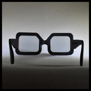 black rectangular big sunglass frames, facing away from the camera