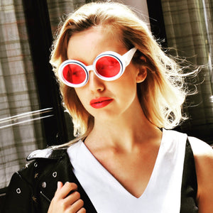 pink and white sunglasses on blonde model