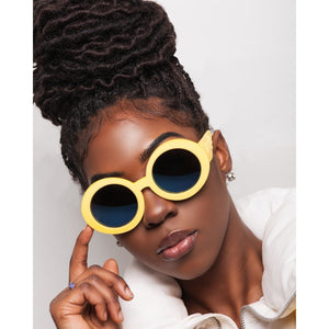 yellow round sunglasses on black model