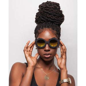 gold sunglasses on black female model