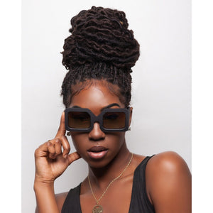 black female model with beehive hair wear black fashion square sunglasses