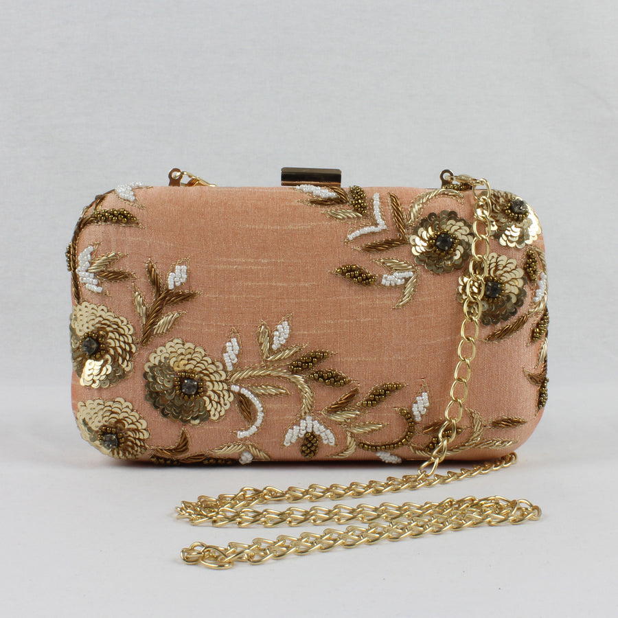 nude peach clutch with gold and white embroidery and gold detachable chain