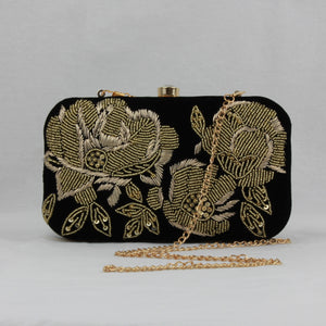 black embroidered clutch bag
