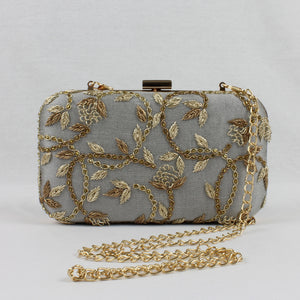 grey clutch with shoulder chain