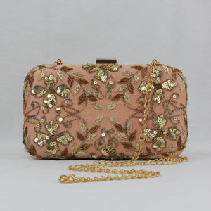 nude peach clutch with gold detail and detachable chain