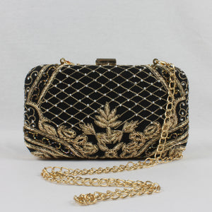 black clutch with gold details and detachable gold chain for weddings