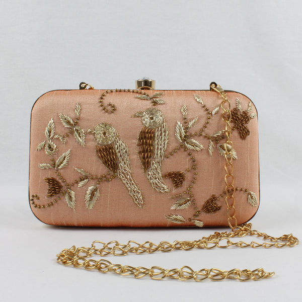 nude pink clutch with gold hand embroidered birds