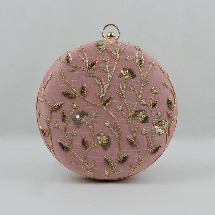 pink clutch bag with gold floral embroidery and chain