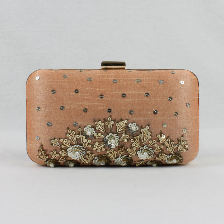 nude peach clutch with sequin details