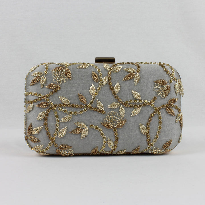 grey clutch bag with gold embroidery
