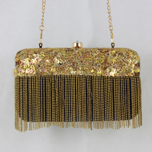 blue bag with gold sequins and tassel