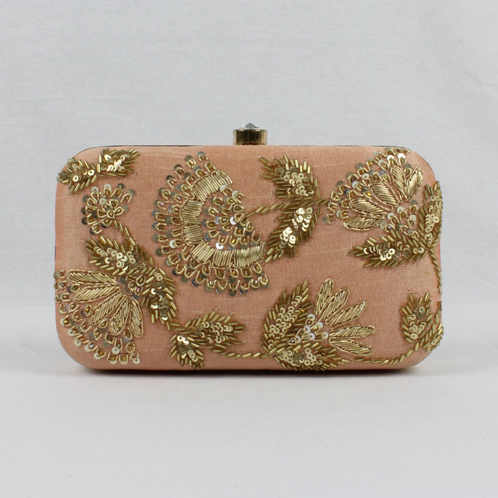 nude peach clutch with gold embroidery