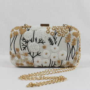 white clutch handbag for indian weddings featuring white and gold hand embroidery flowers