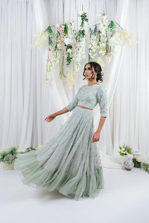 lehenga with flower details and ruffle at the bottom