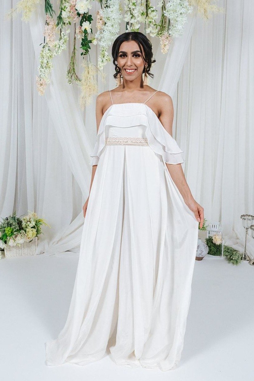 ivory jumpsuit with ruffle detailing and gold waistbelt