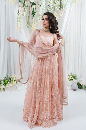 pastel pink bridal lehenga with lace embroidery