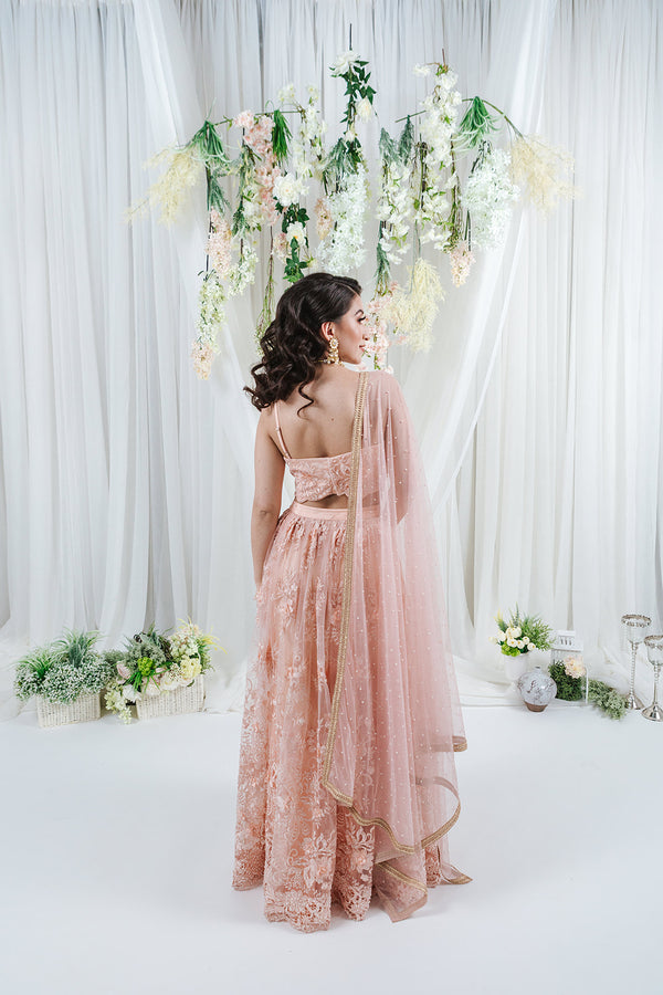 heavy embroidered pink lace net and pearl lehenga set for punjabi wedding