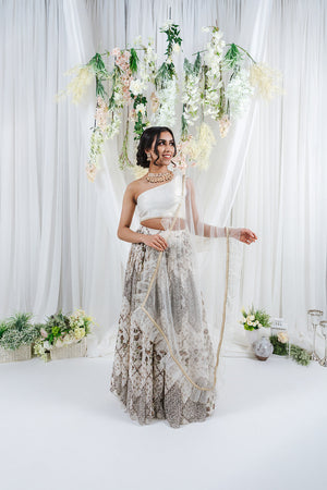 white net dupatta with ruffle frill around the edges with gold border