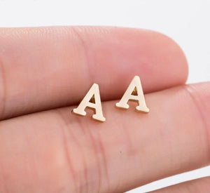 (A) letter earrings