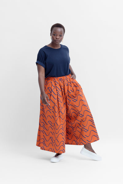 Ollie Wide Leg Relaxed Organic Cotton Pants Model Front Angled | COPPER/COBALT