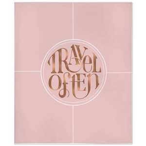 Fleece throw blanket with Travel Often hand lettering in rose gold on pink blush background