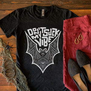 Black t-shirt - Don't Suck My Vibe hand lettered design with illustration of bat