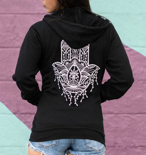 Hamsa Hand detailed design on zip-up hoodie featuring the evil eye and lotus.