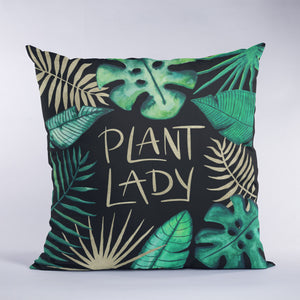 Square pillow with Plant Lady lettering and tropical leaves with black and gold