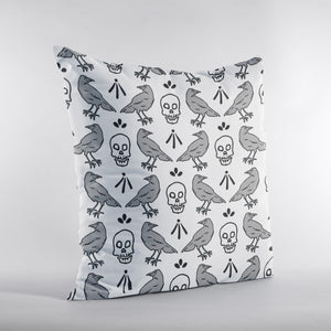 Throw pillow with skull and crow pattern illustration. Grey and Black pattern on white pillow.