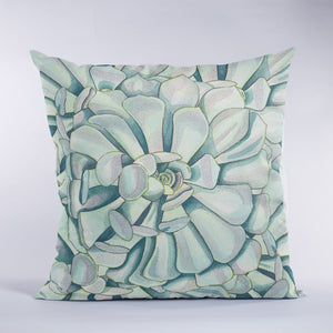 Throw pillow with succulent design in green and soft teal