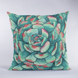 Throw pillow with succulent artwork in green, teal and red.