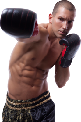 Professional Male boxer in gold and black trunks and red boxing gloves