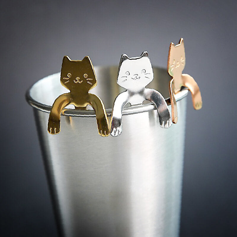 Cat products for your home like cat spoons, kitty pillows and more for your cat lady kitchen and living room