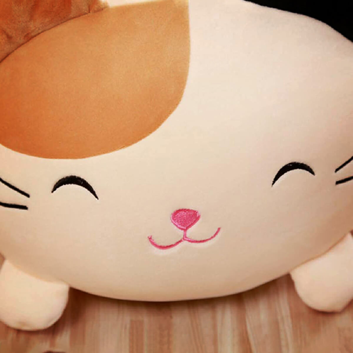 Cute Kawai Cat Pillow - close up of beige smiling cat cushion with closed eyes