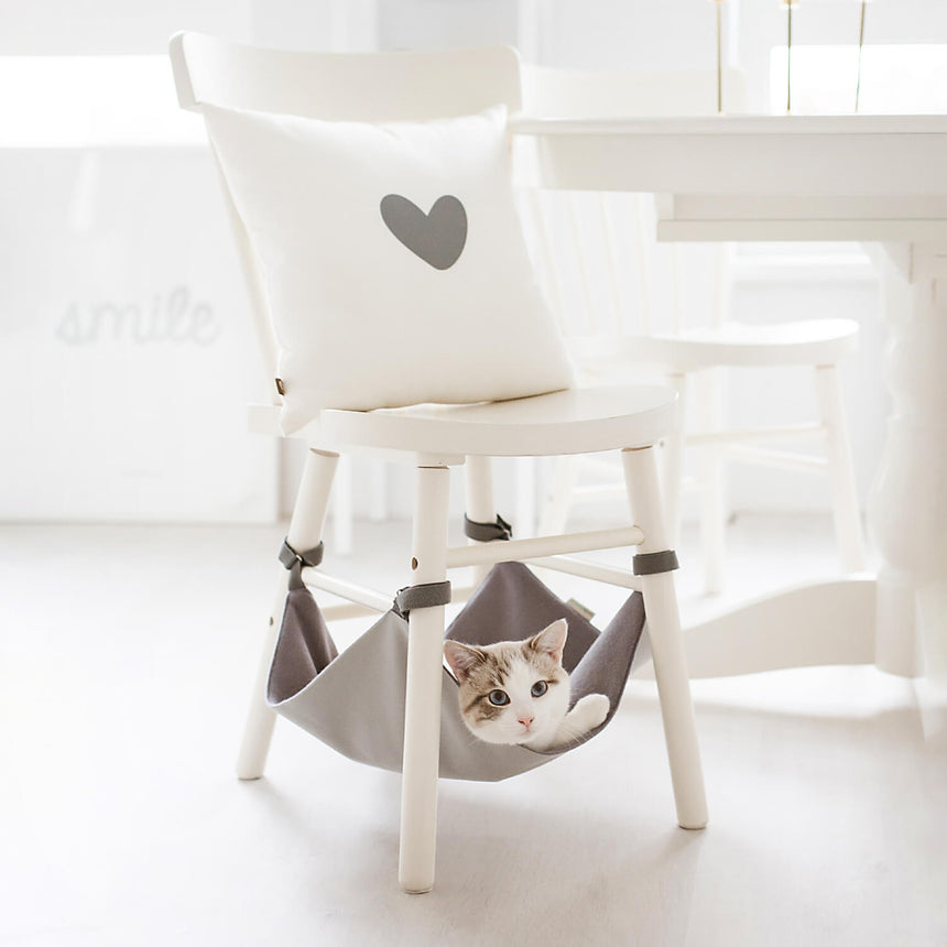 Kitty Hammock - Cat Bed & Chair Storage - image of white cat in light grey chair hammock room example