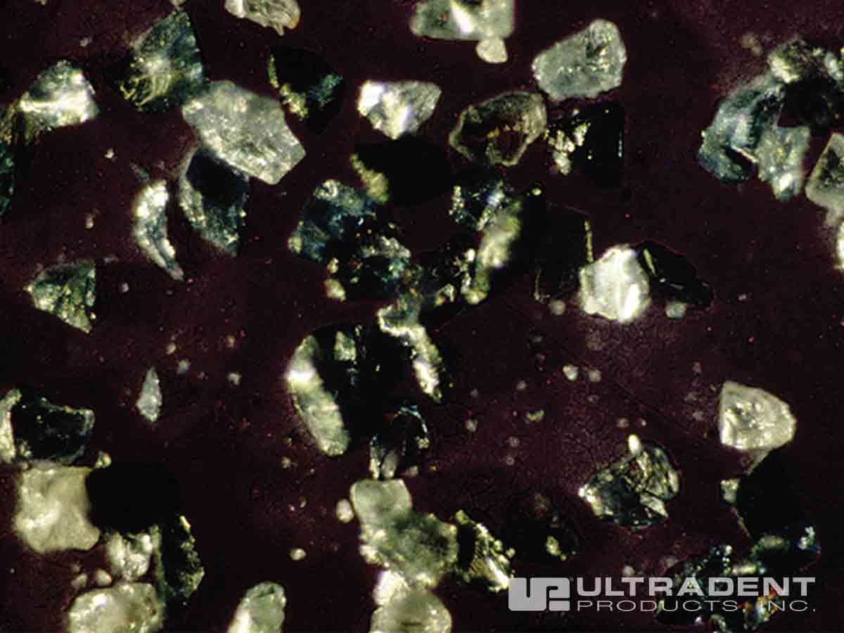 Silicon carbide microparticles contained in Opalustre abrasion slurry.