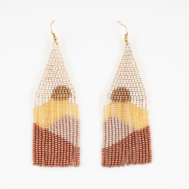 beaded earrings with a cream triangle top, a bronze half circle design within the beads then fringe in layers of gold, mauve and bronze.