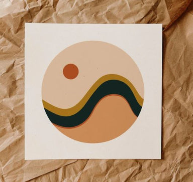 Abstract wave print has a circle design with a peachy clay color on bottom, black and mustard waves in the middle and at the top a pale sky with an orange sun in the top left.