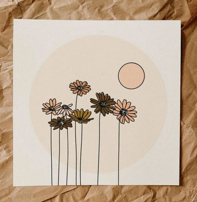 Art print featuring daisies in pink and taupe colors in a pake pink circle, with peach sun above that, and white background
