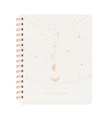 white spiral bound planner with gold foil design of moon phases and stars